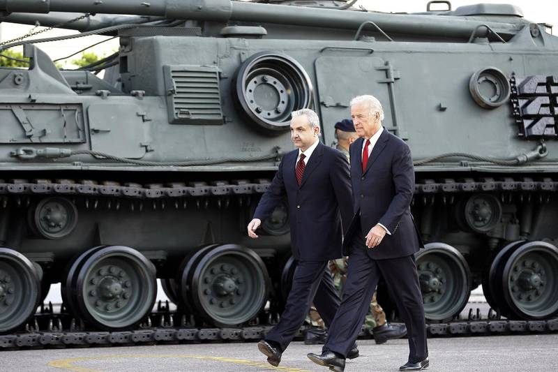 US Vice President Joe Biden (R) and Lebanese Defence Minister Elias Murr walk past a US-made tank during a ceremony at the Rafiq Hariri international airport in Beirut on May 22, 2009. Biden said that Washington will determine its aid to Lebanon based on the outcome of a tightly contested legislative election that the Islamist group Hezbollah could win. He wrapped up his seven-hour visit at Beirut airport, standing before an array of military equipment, including tanks, armoured personnel carriers and helicopters that he said are part of more than half a billion dollars in US military assistance to Lebanon since 2005. AFP PHOTO/JOSEPH BARRAK (Photo by JOSEPH BARRAK / AFP)