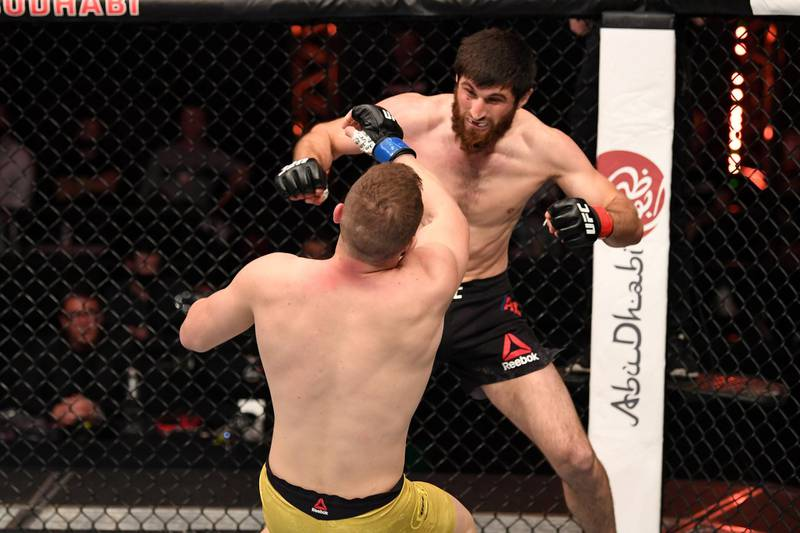 ABU DHABI, UNITED ARAB EMIRATES - OCTOBER 24:  (R-L) Magomed Ankalaev of Russia knocks down Ion Cutelaba of Moldova in their light heavyweight bout during the UFC 254 event on October 24, 2020 on UFC Fight Island, Abu Dhabi, United Arab Emirates. (Photo by Josh Hedges/Zuffa LLC via Getty Images)