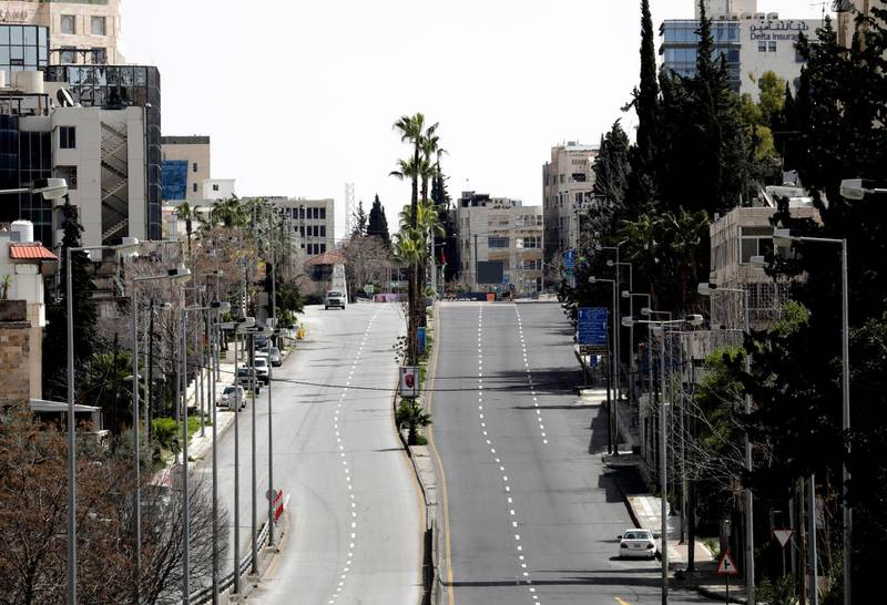 epa08315466 A view of a deserted road on another full curfew day in Amman, Jordan, 23 March 2020. Jordanian government announced a full curfew on 21 March. Only people with a special permit are allowed to leave their homes and circulate in the streets. The authorities announced on 23 March that delivery of bread, medication drinking water, fuel or gas and children milk will be organized from the 24 March. Jordan has 112 cases of COVID-19 Coronavirus so far.  EPA/AMEL PAIN