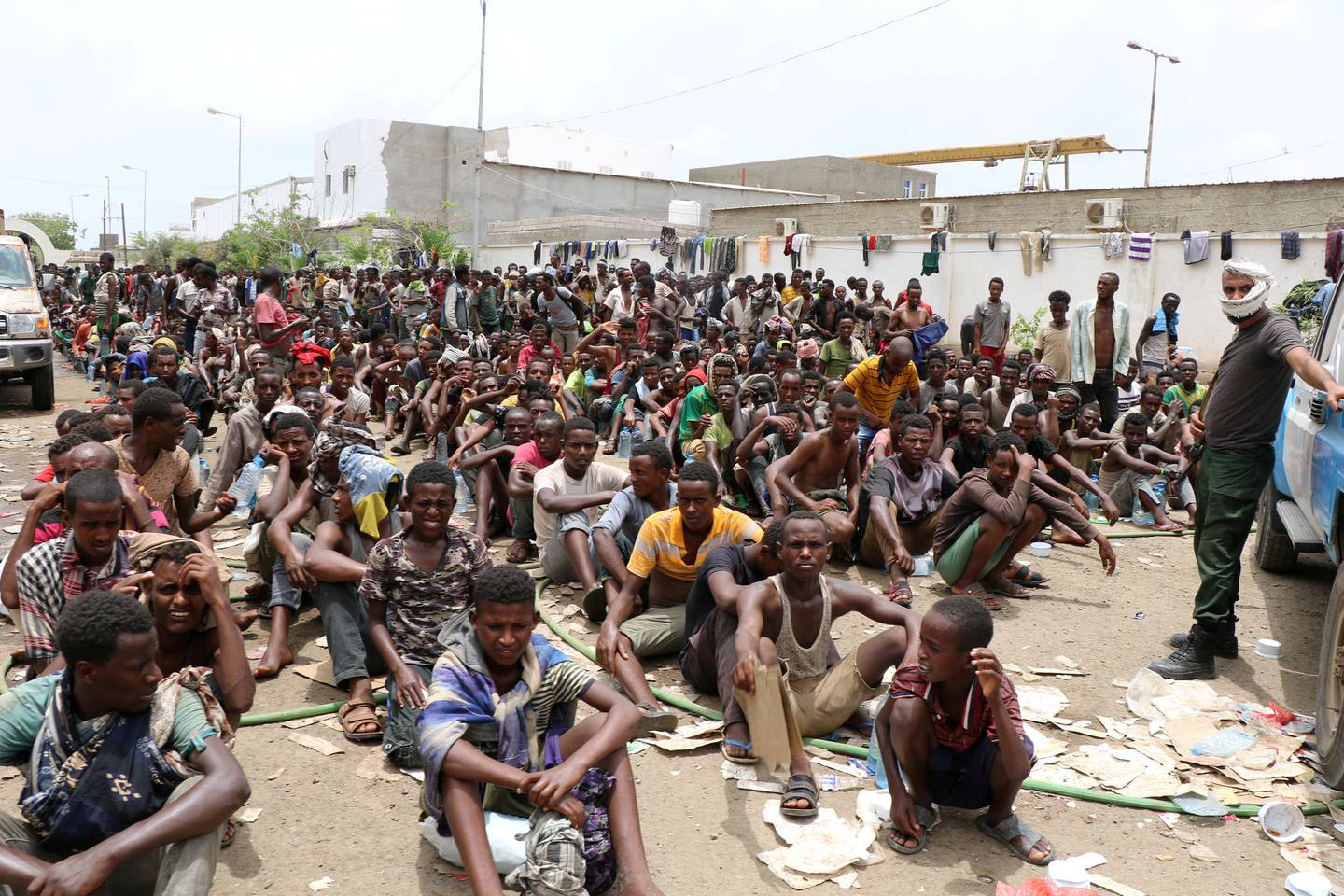 FILE PHOTO: Ethiopian migrants, stranded in war-torn Yemen, sit on the ground of a detention site pending repatriation to their home country, in Aden, Yemen April 24, 2019. REUTERS/Fawaz Salman/File Photo