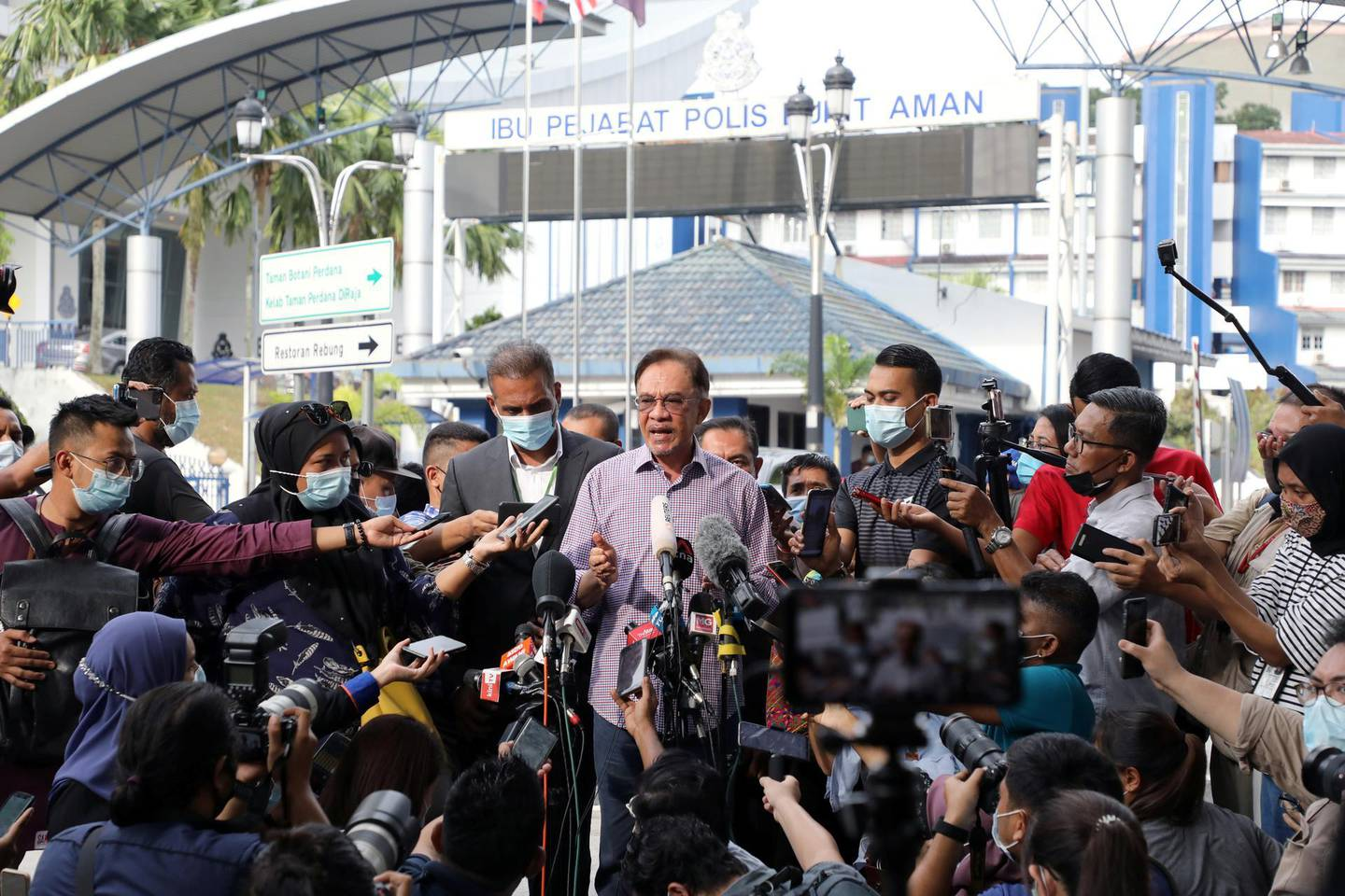 Malaysia opposition leader Anwar Ibrahim speaks to media members after being questioned by the Malaysian police over an investigation of a viral list of 121 federal lawmakers, allegedly backing his bid to take over the premiership from Muhyiddin Yassin, outside Bukit Aman police headquarters, in Kuala Lumpur, Malaysia October 16, 2020. REUTERS/Lim Huey Teng