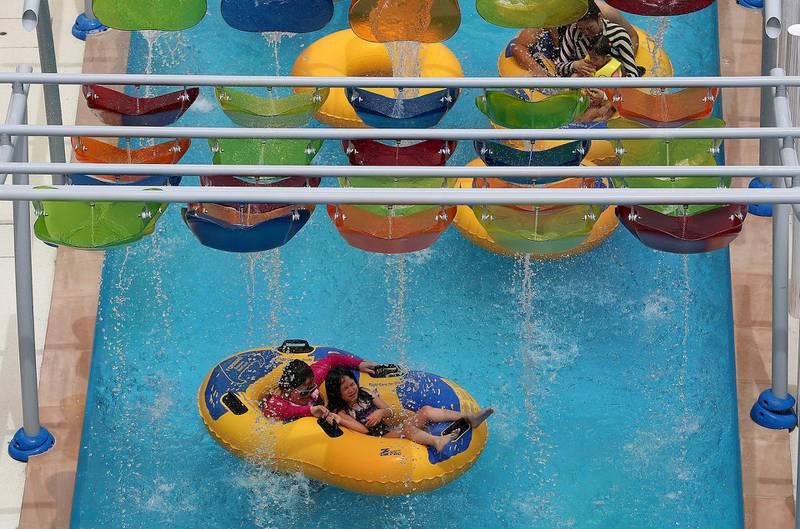 DUBAI , UNITED ARAB EMIRATES , MAY 12 – 2018 :- People enjoying in the Laguna Waterpark in La Mer in Dubai.  ( Pawan Singh / The National )  For News/ Big Picture / Weekend. Story by Salam Al Amir