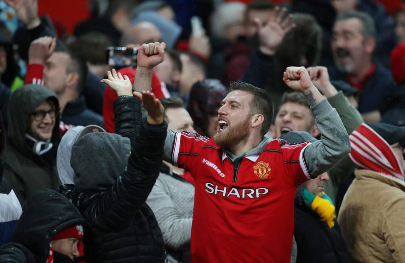 """Soccer Football - Premier League - Manchester United v Manchester City - Old Trafford, Manchester, Britain - March 8, 2020  Manchester United fans celebrates their second goal   Action Images via Reuters/Carl Recine  EDITORIAL USE ONLY. No use with unauthorized audio, video, data, fixture lists, club/league logos or """"live"""" services. Online in-match use limited to 75 images, no video emulation. No use in betting, games or single club/league/player publications.  Please contact your account representative for further details."""