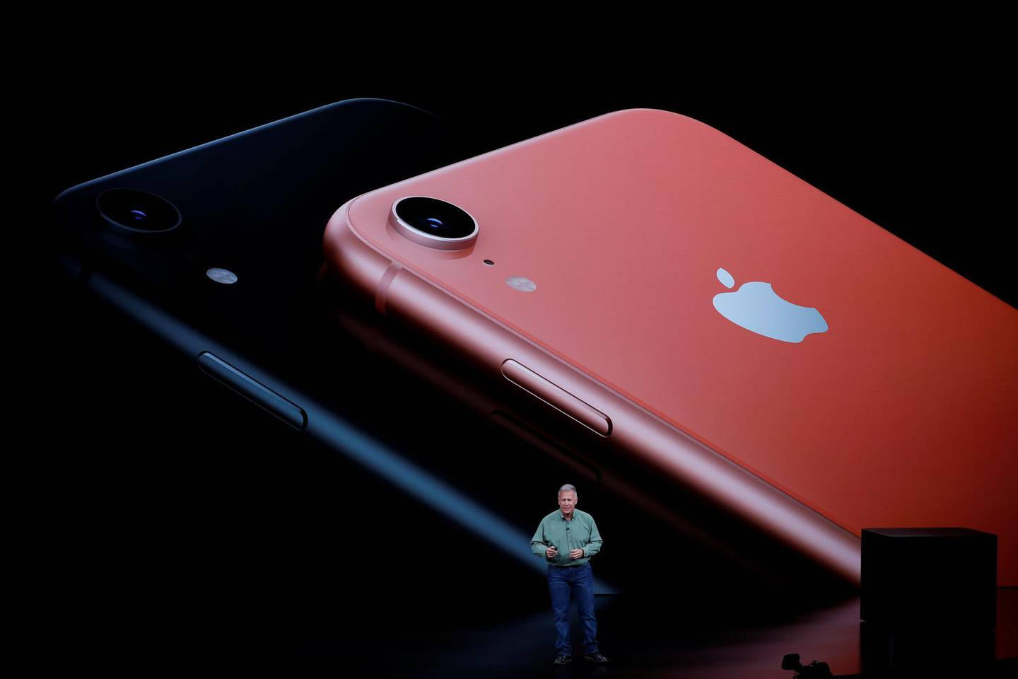 FILE PHOTO: Philip W. Schiller, Senior Vice President, Worldwide Marketing of Apple, speaks about the new Apple iPhone XR at an Apple Inc product launch event at the Steve Jobs Theater in Cupertino, California, U.S., September 12, 2018. REUTERS/Stephen Lam/File Photo