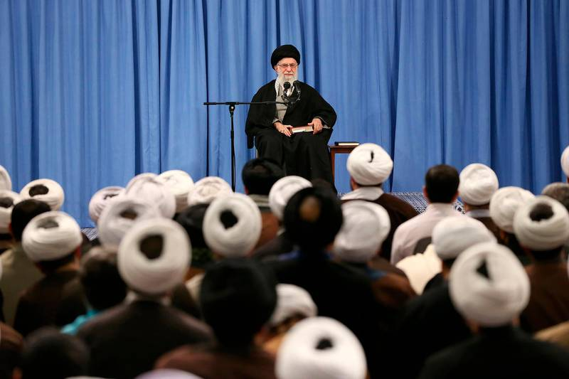"""In this photo released by an official website of the office of the Iranian supreme leader, Supreme Leader Ayatollah Ali Khamenei speaks in a meeting in Tehran, Iran, Sunday, Feb. 23, 2020. Officials in Iran haven't announced the full results from parliamentary elections two days ago, but on Sunday the country's supreme leader accused enemy """"propaganda"""" of trying to disuade people from voting by amplifying the threat of the coronavirus. (Office of the Iranian Supreme Leader via AP)"""