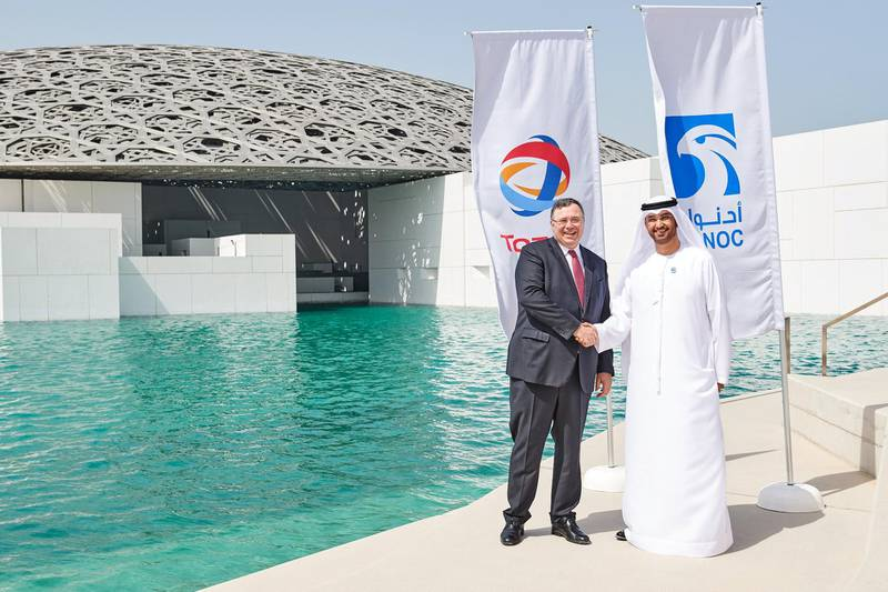 Patrick Jean Pouyanné, chairman and CEO of Total shake hands with Dr. Sultan Ahmed Al Jaber, Minister of State and Director-General and CEO of the Abu Dhabi National Oil Company, after signing a Major Offshore Concession Agreements with Total as it Embarks on Giant Gas Cap Development in Abu Dhabi. Courtesy: ADNOC