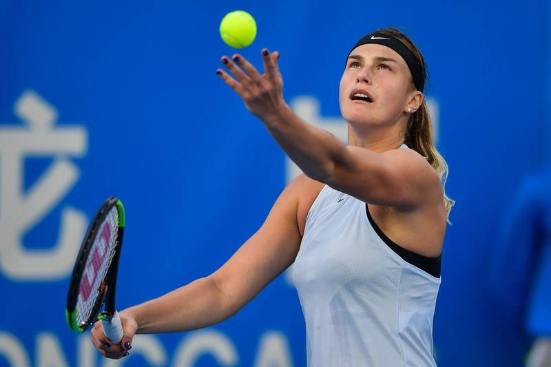 Aryna Sabalenka of Belarus serves to Simona Halep of Romania during their women's singles quarter-final match at the WTA Shenzhen Open tennis tournament in Shenzhen in China's southern Guangdong province on January 4, 2018. / AFP PHOTO / - / China OUT