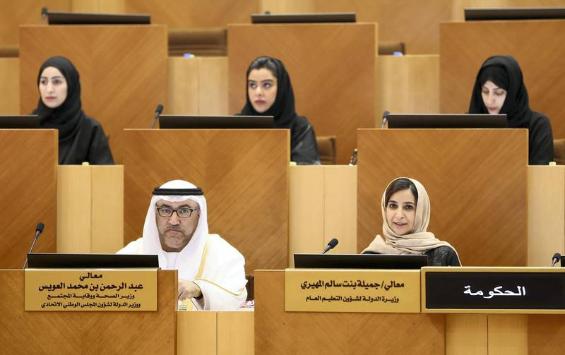 ABU DHABI , UNITED ARAB EMIRATES ,  November 20 , 2018 :- Left to Right - Abdul Rahman Bin Mohammed Al Owais , Minister of Health , UAE and Jameela bint Salem Al Muhairi , Cabinet Member and Minister of State for Public Education, UAE during the Federal National Council session held at FNC office in Abu Dhabi. ( Pawan Singh / The National )  For News. Story by Haneen