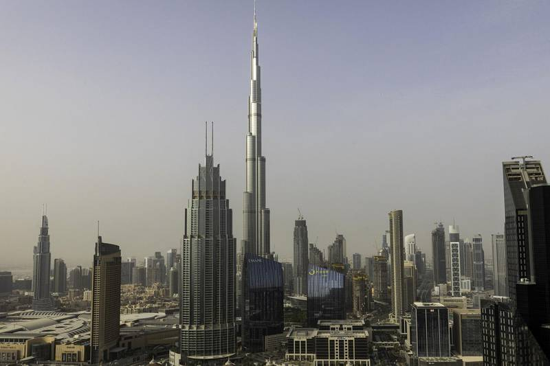 The Burj Khalifa skyscraper, center, towers above commercial and residential properties in Dubai, United Arab Emirates, on Tuesday, July 23, 2019. Like the rest of the city, the business center has suffered from a prolonged real-estate slump brought on by oversupply and slower economic growth. Photographer: Christopher Pike/Bloomberg