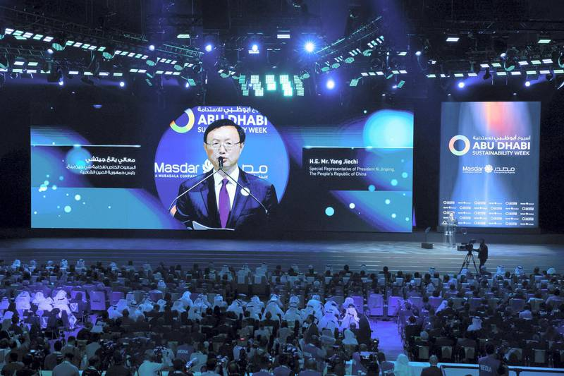 ABU DHABI, UNITED ARAB EMIRATES - January 14, 2019: HE Yang Jiechi, Special Representative of the Chinese President (on screen), delivers the key note speech during the opening ceremony of the World Future Energy Summit 2019, part of Abu Dhabi Sustainability Week, at Abu Dhabi National Exhibition Centre (ADNEC).  ( Hamed Al Mansoori / Ministry of Presidential Affairs ) ---