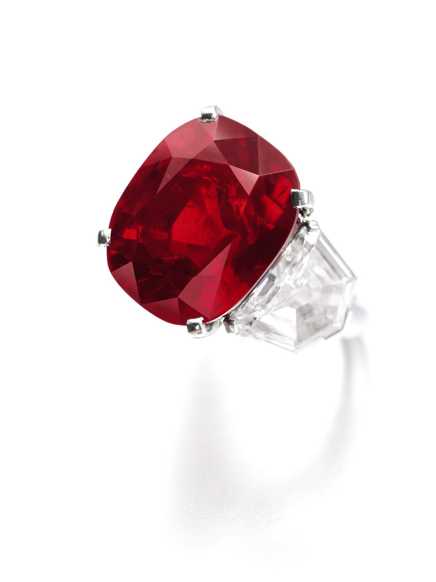 LOT 502 Property of a Lady 'The Sunrise Ruby', A superb and extremely rare ruby and diamond ring weighing 25.59 carats, Cartier Estimate: CHF 11,700,000-17,500,000 / US$ 12,000,000-18,000,000 Sold for CHF 28,250,000 (US$ 30,335,698) CREDIT: Sotheby's *** Local Caption ***  al99 sothebys BLOG 2.jpeg