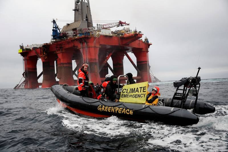 Greenpeace boat alongside the BP-chartered Transocean 'The Paul B Loyd Jr' rig en route to the Vorlich field in the North Sea. The Greenpeace ship the Arctic Sunrise has been following the BP rig as it heads to the North Sea drilling site. The rig undertook a U-turn when it arrived at the site and is heading back towards Scotland. Greenpeace is calling on BP to halt drilling for new oil in light of the climate emergency and refocus their business on renewable energy.