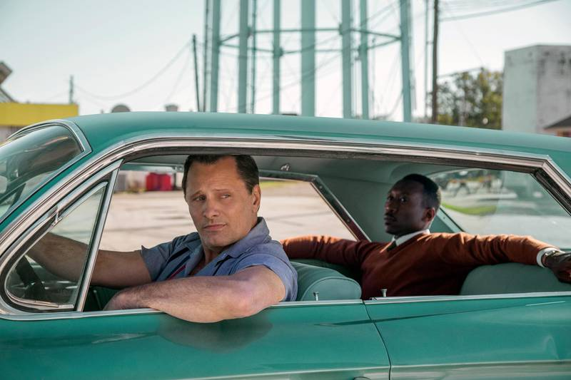 """This image released by Universal Pictures shows Viggo Mortensen, left, and Mahershala Ali in a scene from """"Green Book."""" On Thursday, Dec. 6, 2018, the film was nominated for a Golden Globe award for best motion picture musical or comedy. The 76th Golden Globe Awards will be held on Sunday, Jan. 6. (Patti Perret/Universal Pictures via AP)"""