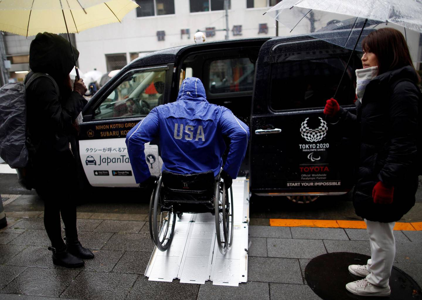 Paralympian Daniel Romanchuk of the U.S. enters a Toyota Motor Corp.'s JPN Taxi during his tour of Tokyo, Japan March 4, 2019. Picture taken March 4, 2019.   REUTERS/Issei Kato