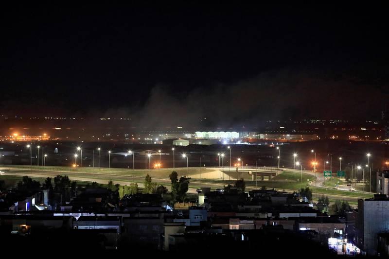 Smoke rises over the Erbil, after reports of mortar shells landing near Erbil airport, Iraq February 15, 2021. REUTERS/Thaier al-Sudani