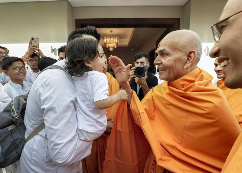 Dubai,  April 22, 2019.  His Holliness Mahant Swami Maharaj blesses a child.Victor Besa/The National Section:  NAReporter:  Ramola Talwar