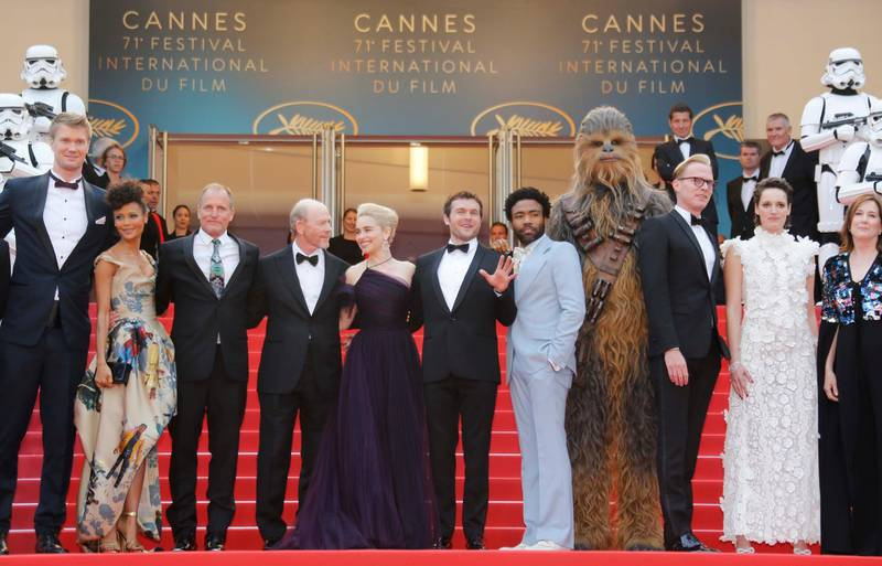 """71st Cannes Film Festival - Screening of the film """"Solo: A Star Wars Story"""" out of competition - Red Carpet Arrivals - Cannes, France May 15, 2018. Director Ron Howard, Star Wars' character Chewbacca and cast members Alden Ehrenreich, Donald Glover, Woody Harleson, Emilia Clarke, Joonas Suotamo, Thandie Newton, Phoebe Waller-Bridge, Paul Bettany pose. REUTERS/Regis Duvignau"""