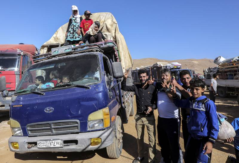 epa06906443 Syrian refugees sit inside their cars waiting to be evacuated from their refugee camps in the village of Arsal, east of Lebanon, 23 July 2018, to return home to their villages in al-Qalamoun area in the western Damascus countryside. According to media reports, Lebanon hosts 1,011,366 Syrian refugees registered with UNHCR, Including 80 thousand refugees living in seven camps in the city of Arsal. 850 person who have permission from the Syrian authority left to return home on 23 July 2018, where tousends of Syrian refugees families registers their names and wait the syrian permission.  EPA/NABIL MOUNZER