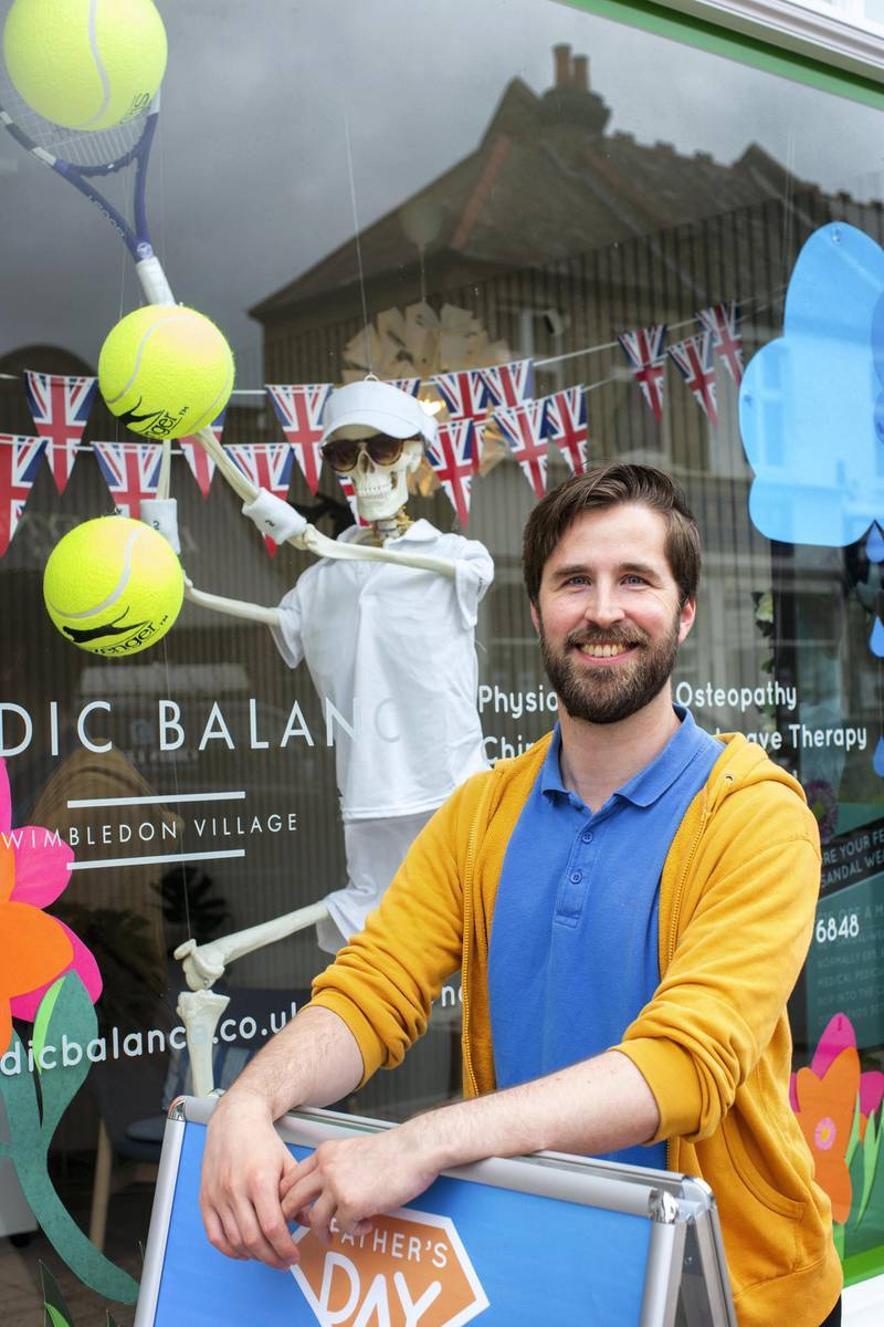 In the run up to the Wimbledon tennis championship reporter Tim Stickings and I visited and interviewed locals to guage the feeling ahead of the competition. Reception manager at Nordic Ballance  John Conradi, 29, infront of their comedic tennis themed window display.