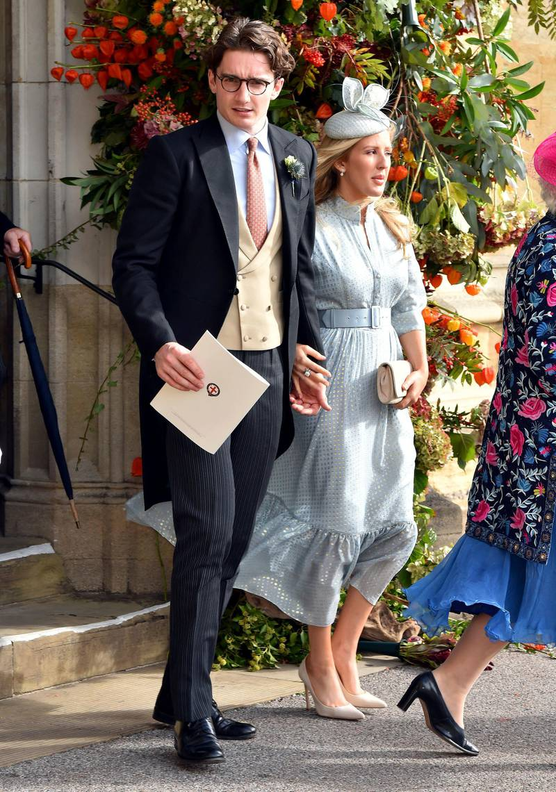 FILE - In this Oct. 12, 2018 file photo,  Caspar Joplin, left, and singer Ellie Goulding depart after the wedding of Princess Eugenie of York and Jack Brooksbank at St George's Chapel, Windsor Castle, near London, England.  Goulding married Jopling in a lavish ceremony Saturday, Aug. 31, 2019 with pals Katy Perry, Orlando Bloom and Sienna Miller in attendance. The two tied the knot in Yorkshire, England, at the gothic York Minster Cathedral.(Matt Crossick, Pool via AP, File)