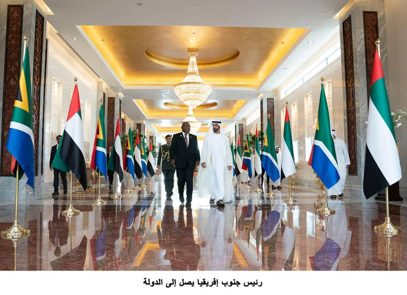 ABU DHABI, UNITED ARAB EMIRATES - July 13, 2018: HH Sheikh Mohamed bin Zayed Al Nahyan Crown Prince of Abu Dhabi Deputy Supreme Commander of the UAE Armed Forces (R), receives HE Cyril Ramaphosa, President of South Africa (L), at the Presidential Airport. ( Mohamed Al Hammadi / Crown Prince Court - Abu Dhabi )---