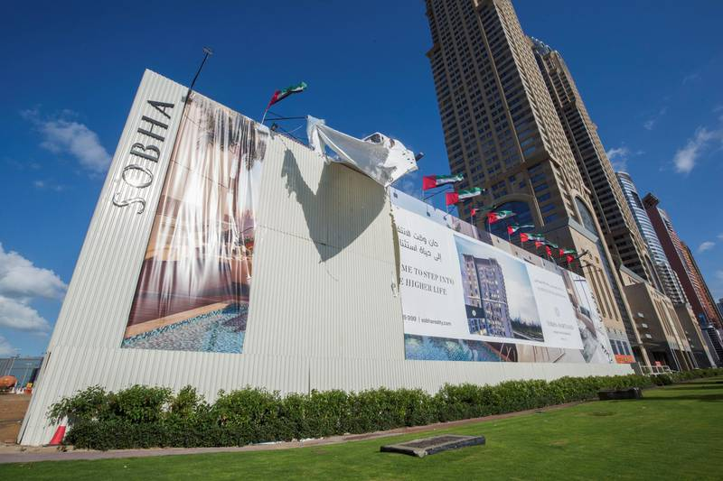 Dubai, United Arab Emirates - Sobha sign board ripped by winds at Sheikh Zayed Road  Ruel Pableo for The National