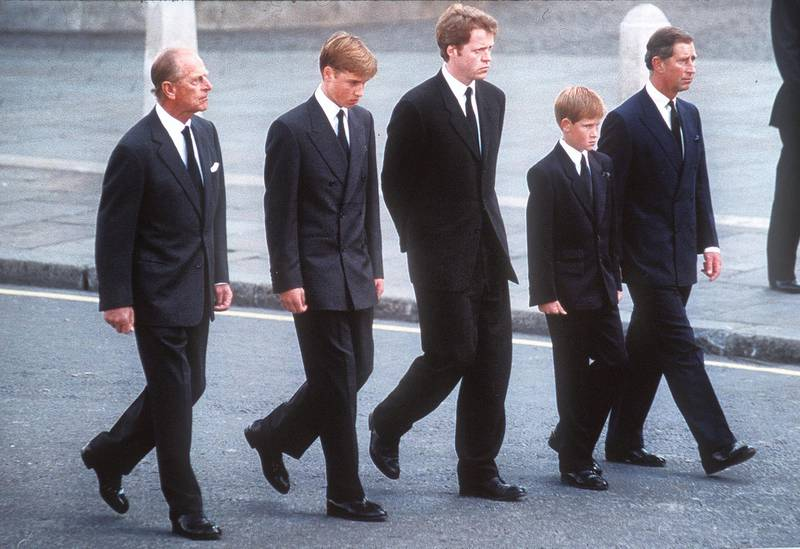 LONDON, ENGLAND - SPETEMBER 6:  (FILE PHOTO) Prince Philip, the Duke of Edinburgh, Prince William, Earl Spencer, Prince Harry and Prince Charles, the Prince of Wales follow the coffin of Diana, Princess of Wales this in September 6, 1997 file photo in London, England.  The funeral took place seven days after she was killed in an automobile accident in Paris. Members of the royal family walked in the procession behind the coffin, as did 500 representatives of the charities associated with the Princess.  At least a million people lined the streets of central London to watch the procession from Kensington Palace to Westminster Abbey.   (Photo by Anwar Hussein/Getty Images)