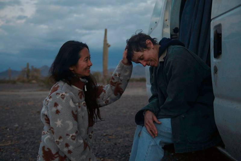 """FILE - In this file photo, Director Chloe Zhao, left, appears with actress Frances McDormand on the set of """"Nomadland.""""  """"Nomadland"""" has won four prizes, including best picture, at the British Academy Film Awards on Sunday, April 11, 2021. The film's director, Chloe Zhao, became only the second woman to win the best director trophy, and star Frances McDormand was named best actress. """"Nomadland"""" also took the cinematography prize on Sunday. Emerald Fennell's revenge comedy """"Promising Young Woman"""" was named best British film, while the best actor trophy went to 83-year-old Anthony Hopkins for playing a man grappling with dementia in """"The Father."""" An event that was criticized in the recent past with the label #BAFTAsSoWhite rewarded a diverse group of talents, during a pandemic-curbed ceremony at London's Royal Albert Hall. (Searchlight Pictures via AP, FIle)"""