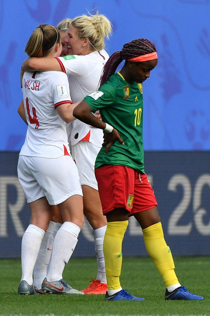 England's players celebrate at the end of the France 2019 Women's World Cup round of sixteen football match between England and Cameroon, on June 23, 2019, at the Hainaut stadium in Valenciennes, northern France. (Photo by Philippe HUGUEN / AFP)