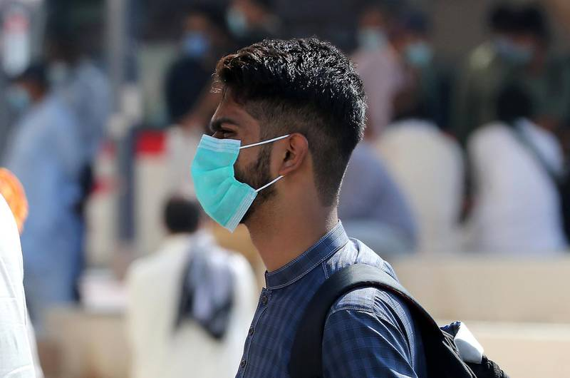 DUBAI, UNITED ARAB EMIRATES , October 9 – 2020 :- A man wearing protective face mask as a preventive measure against the spread of coronavirus in Bur Dubai area in Dubai. (Pawan Singh / The National) For News/Stock/Online.