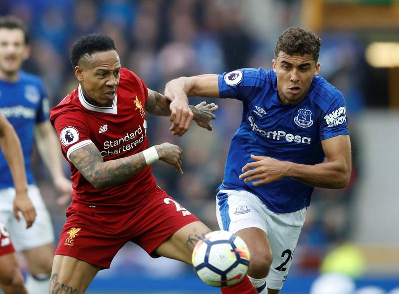 """Soccer Football - Premier League - Everton vs Liverpool - Goodison Park, Liverpool, Britain - April 7, 2018   Everton's Dominic Calvert-Lewin in action with Liverpool's Nathaniel Clyne   Action Images via Reuters/Carl Recine    EDITORIAL USE ONLY. No use with unauthorized audio, video, data, fixture lists, club/league logos or """"live"""" services. Online in-match use limited to 75 images, no video emulation. No use in betting, games or single club/league/player publications.  Please contact your account representative for further details. - RC1C9E9CE400"""