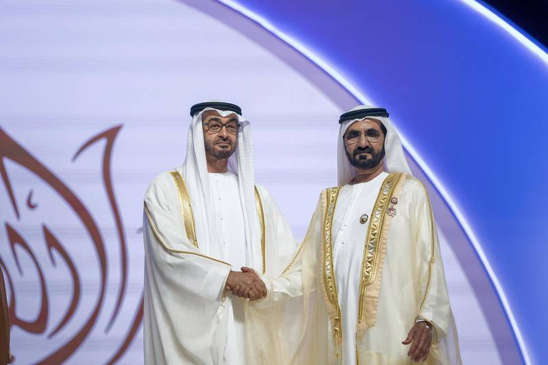 ABU DHABI, UNITED ARAB EMIRATES - November 22, 2017: HH Sheikh Mohamed bin Zayed Al Nahyan, Crown Prince of Abu Dhabi and Deputy Supreme Commander of the UAE Armed Forces (L) presents the Order of the Mother of the Nation to HH Sheikh Mohamed bin Rashid Al Maktoum, Vice-President, Prime Minister of the UAE, Ruler of Dubai and Minister of Defence (R), during the HH Sheikha Fatima bint Mubarak Awards for Excellence and Social Creativity, at Emirates Palace.  ( Mohamed Al Hammadi / Crown Prince Court - Abu Dhabi ) ---