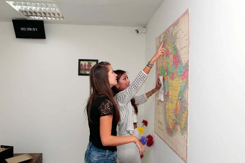 Dubai, United Arab Emirates - October 29, 2014.  ( Left to Right ) Amanda Simpson ( 25 years old from UK ) and Angela Mao ( 28 years old from USA ) got 39.51 minutes to solve the puzzle.  ( Jeffrey E Biteng / The National )  Editor's Note; Dana M reports.