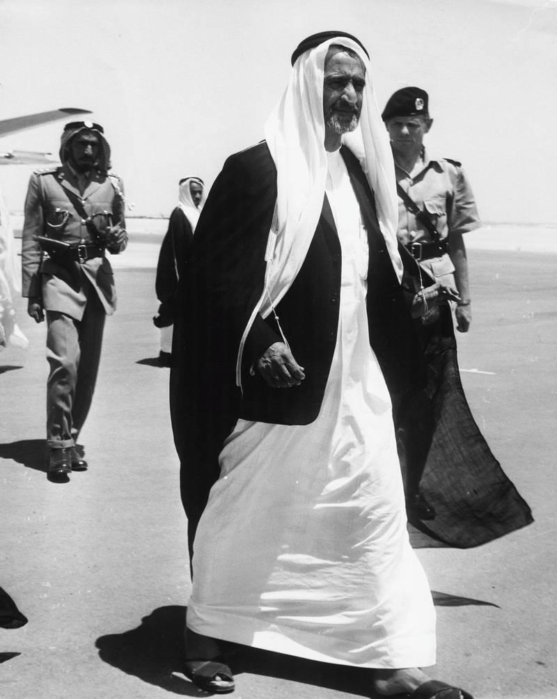 Sheikh Rashid bin Saeed Al Maktoum, with Chief of Police John Briggs behind him, at Dubai Airport, circa 1960. (Photo by Keystone Features/Hulton Archive/Getty Images)