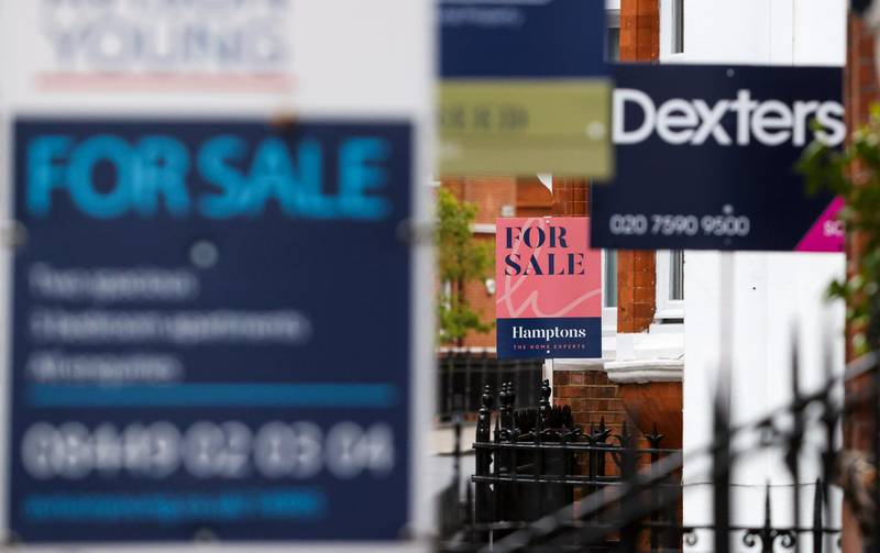 Estate agents boards outside residential properties in the Chelsea area of London, U.K., on Friday, May 21, 2021. After a year of shunning the capital amid lockdowns and coronavirus, many renters are now looking to return to urban life as restrictions ease, according to data from estate agent Hamptons International. Photographer: Chris Ratcliffe/Bloomberg via Getty Images