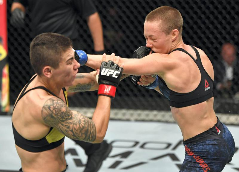 ABU DHABI, UNITED ARAB EMIRATES - JULY 12: (R-L) Rose Namajunas and Jessica Andrade of Brazil trade punches in their strawweight fight during the UFC 251 event at Flash Forum on UFC Fight Island on July 12, 2020 on Yas Island, Abu Dhabi, United Arab Emirates. (Photo by Jeff Bottari/Zuffa LLC)