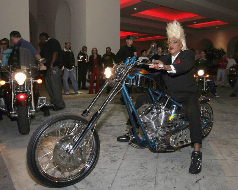 """HOLLYWOOD, FL - DECEMBER 2 : Dennis Rodman arrives on a Harley Davidson motorcycle to sign his new book """"I Should Be Dead By Now"""" inside Hollywood Choppers at Seminole Hard Rock Hotel and Casino on December 2, 2005 in Hollywood, Florida. (Photo by Ralph Notaro/Getty Images)"""