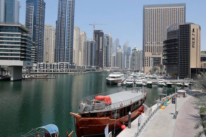 DUBAI, UNITED ARAB EMIRATES , April 17– 2020 :- Yachts parked near Dubai Marina Mall in Dubai. Dubai is conducting 24 hours sterilisation programme across all areas and communities in the Emirate and told residents to stay at home. UAE government told residents to wear face mask and gloves all the times outside the home whether they are showing symptoms of Covid-19 or not.  (Pawan Singh / The National) For News/Online/Instagram