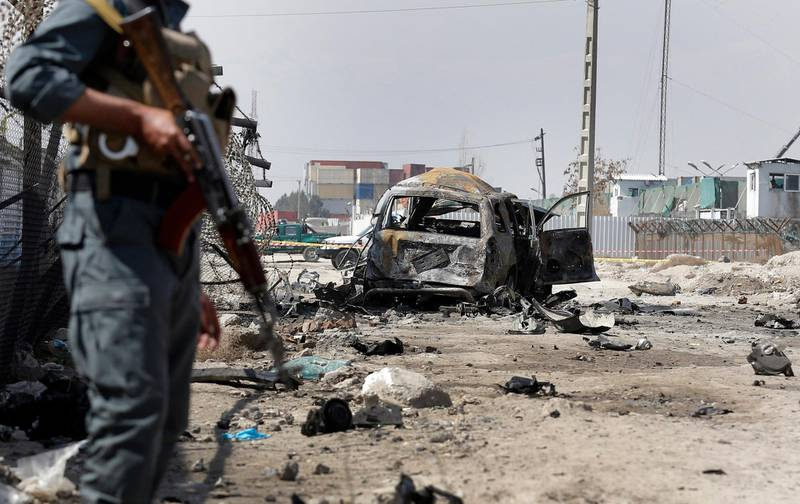 epa06609514 Afghan security officials inspect the scene of a suicide car bomb attack in Kabul, Afghanistan, 17 March 2018. A suicide attacker blew up a bomb in a car at Kabul, killing at least two civilians. Several others were reportedly injured in the blast claimed by the Taliban that the Afghan interior ministry said had targeted the global security company G4S.  EPA/HEDAYATULLAH AMID
