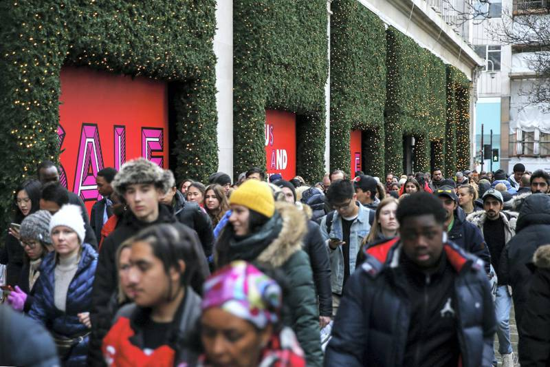 LONDON, ENGLAND - DECEMBER 26: Crowds of shoppers pass Selfridges during the Oxford Street Boxing Day Sales on December 26, 2019 in London, England. (Photo by Hollie Adams/Getty Images)