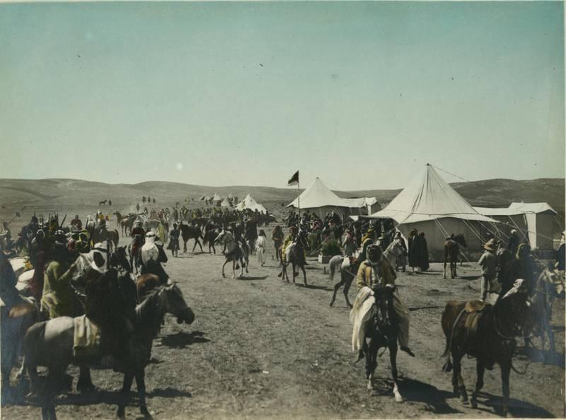 Arab men on horseback in line near tents, Amir Abdullah's camp, Amman. Meetings of British, Arab, and Bedouin officials in Amman, Jordan, April 1921. Courtesy Library of Congress, Prints & Photographs Division