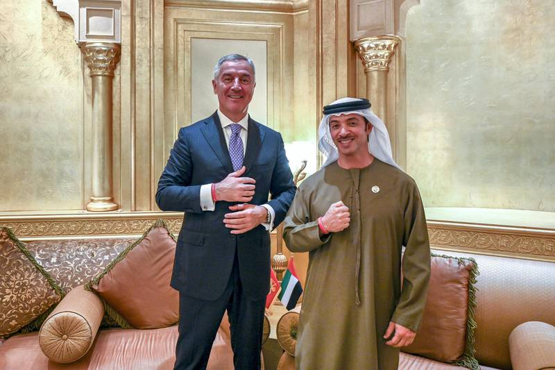ABU DHABI, UNITED ARAB EMIRATES - January 15, 2019: HH Sheikh Hazza bin Zayed Al Nahyan, Vice Chairman of the Abu Dhabi Executive Council (R) and HE Milo Djukanovic, President of Montenegro (L) stand for a photograph wearing the Special Olympics World Games Abu Dhabi 2019 wrist band, at the Emirates Palace. ( Saeed Al Neyadi / Ministry of Presidential Affairs ) ---