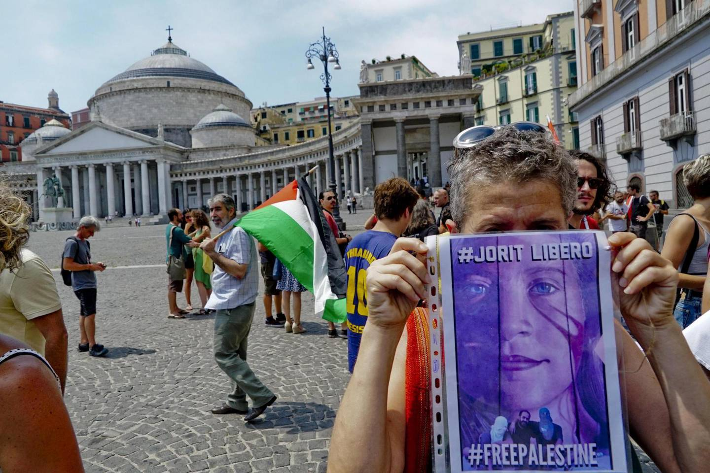 epa06917322 People take part in a solidarity demonstration with Italian street artist Jorit Agoch, who was arrested by the Israeli police on charges of having damaged and defaced a defense barrier in Bethlehem, in Naples, southern Italy, 29 July 2018. About 250 people participated in the protest holding flags of Palestine and shouting the slogan 'Free Jorit'. Jorit Agoch was arrested on 28 July after he painted a mural of 17-year-old Palestinian activist Ahed Tamimi on the separation wall between the West Bank and Israel. Ahed Tamimi, who was arrested last December after she was filmed slapping an Israeli soldier near Ramallah, in the occupied West Bank, was released from prison on 29 July 2018 after serving nearly eight-month in detention.  EPA/ANSA