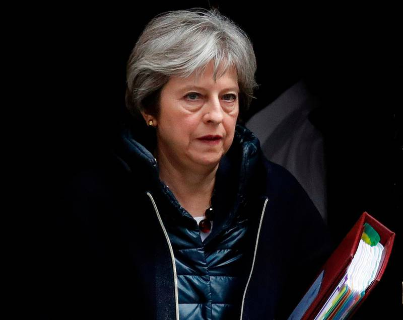 FILE - In this March 14, 2018 file photo Britain's Prime Minister Theresa May leaves 10 Downing Street to attend the weekly Prime Minister's Questions session, in parliament in London. May has summoned her Cabinet back from vacation on Thursday April 12, 2018, to discuss possible military action against Syria over an alleged chemical weapons attack. (AP Photo/Frank Augstein, file)