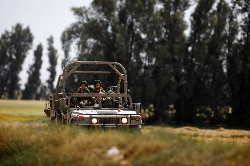 Israeli soldiers drive a military vehicle near the border between Israel and the Gaza Strip, Israel March 18, 2018. REUTERS/Amir Cohen