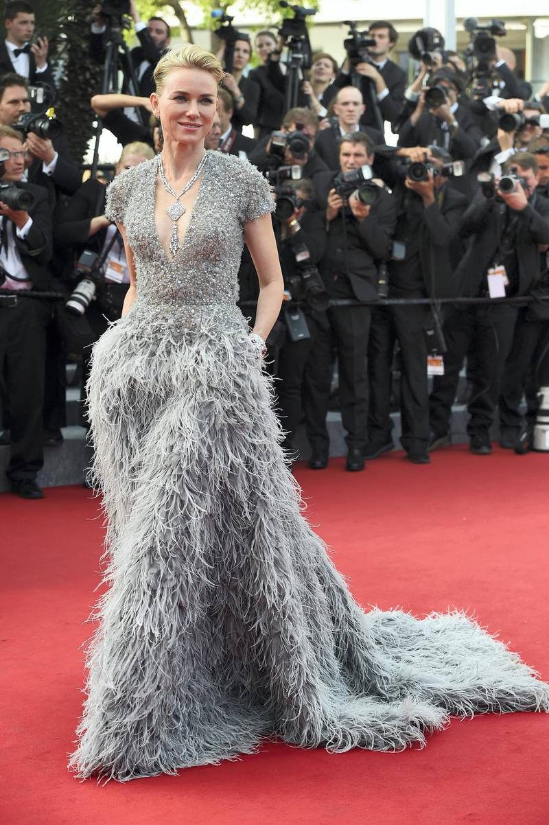 British actress Naomi Watts poses as she arrives for the opening ceremony of the 68th Cannes Film Festival in Cannes, southeastern France, on May 13, 2015.        AFP PHOTO / ANNE-CHRISTINE POUJOULAT (Photo by ANNE-CHRISTINE POUJOULAT / AFP)