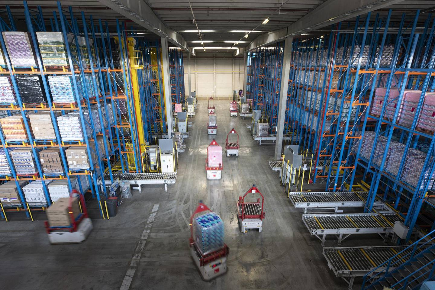 Automated trucks transport crates of retail goods for export to the U.K. inside the ECS European Containers NV computerized warehouse in Zeebrugge, Belgium, on Monday, May 7, 2018. With Brexit due in 10 months, Zeebrugge embodies the repeated warnings by the U.K.'s EU partners that its departure from the bloc is a lose-lose move by adding bureaucracy for businesses and costs for consumers. Photographer: Jasper Juinen/Bloomberg