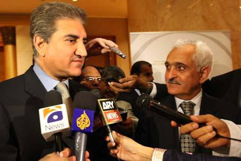 ABU DHABI 12th January 2010.  Shah Mehmood Qureshi (left) the Pakistan Foreign Minister and Rangin Dafdar Spanta, the Afghanistan Foreign Minister talk to the media at the Meeting of Special Representatives for Afghanistan and Pakistan, held at the Emirates Palace , Abu Dhabi yesterday (tues)   Stephen Lock   /  The National   *** Local Caption ***  SL-holbrooke-006.jpg