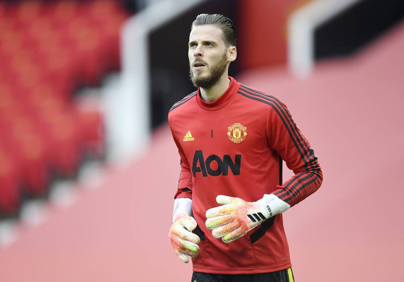 Soccer Football - Premier League - Manchester United v Southampton - Old Trafford, Manchester, Britain - July 13, 2020  Manchester United's David de Gea during the warm up, as play resumes behind closed doors following the outbreak of the coronavirus disease (COVID-19) Pool via REUTERS/Peter Powell EDITORIAL USE ONLY. No use with unauthorized audio, video, data, fixture lists, club/league logos or 'live' services. Online in-match use limited to 75 images, no video emulation. No use in betting, games or single club/league/player publications.  Please contact your account representative for further details.