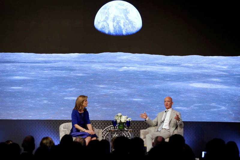 FILE PHOTO: Caroline Kennedy and Jeff Bezos, founder of Amazon and Blue Origin, have a fireside chat  during the JFK Space Summit, celebrating the 50th anniversary of the moon landing, at the John F. Kennedy Library in Boston, Massachusetts, U.S., June 19, 2019. REUTERS/Katherine Taylor/File Photo